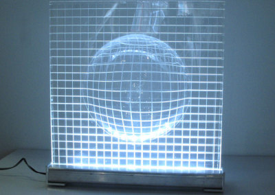 Day One (Ray Lodoen), 2014: plexiglas, aluminum, LED lights; scribed, vacuum formed plexi mounted in aluminum extrusion stand. $500