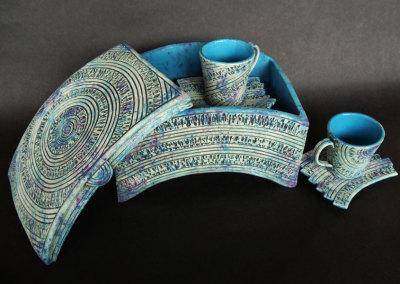 Demitasse-ket-hand built of textured porcelain slab. Under glaze and stain colours.