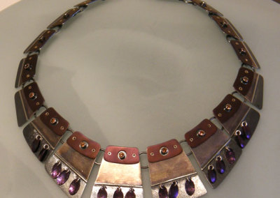 Luxor Collar, Melody Armstrong, 2010, Sterling silver, 14k yellow gold, hessonite garnet, anodized titanium, anodized niobium & patina