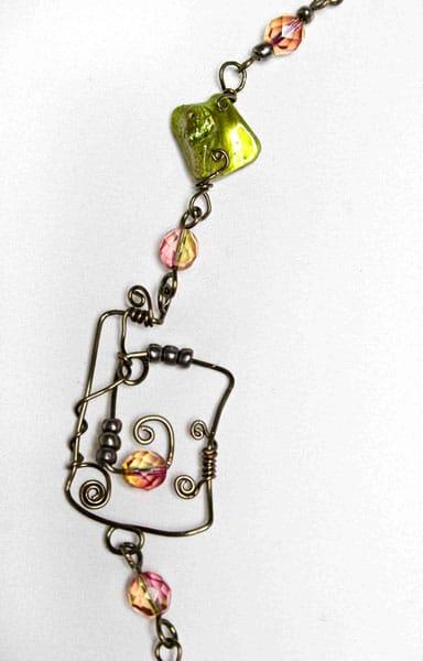 Tendrils, 2009 - Sue Sutherland - Gunmetal wire, shell, glass beads, metallic beads, $225