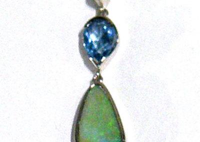 Joan Thomson, Blue Green Pendant: Peridot blue topaz, opal in matrix, white gold; bezel set stones, piercing. 2012, NFS.