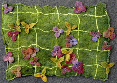 Lesley Sutherland, Covering New Ground: Wool roving, wool yarn, cotton yarn, wool flannel; wet felting, embroidery. 2013, NFS.