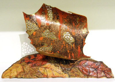 Debra McLeod, Blowing Leaf: Birch, paint, copper leaf, patina; turning, carving, patination, leafing, piercing. 2012, $600.