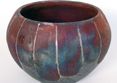 Rainbow Pot-wheel thrown. Glazed and raku fired.