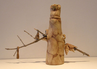Hanging On - Deborah Potter (clay, wooden branch, and underglaze)