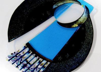 Linda Billo, Fly Me to the Moon: Pattern bars, dichoric, irid glass; fused, slumped, sand blasted. 2013, $900.