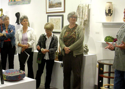 SCC Exhibitions and Education Coordinator speaking to the artists and guests at the closing reception.