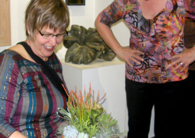 Outgoing SCC Board Member, Cindy Hanson and SCC Executive Director, Sherry Luther admiring the succulent bowl that was presented during the reception to thank Cindy for her contribution. Outgoing Board Member, Paul Constable was not in attendance to receive his.