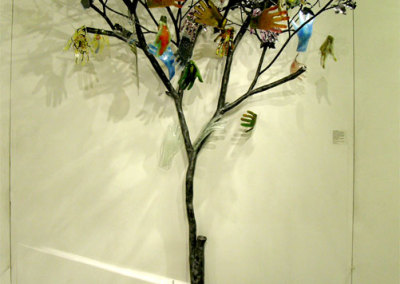 Tree of Hands, (Glass Hands: Herman Boerma, Kimberly Dickinson, Doris Grant, Al Hiebert, Joan Hiebert, Sue Hunchuck, Bill Popiel, Bob Miller, Elisabeth Miller, Robert Miller, Lennekë Verweij - Tree: Rob Sexaure – Dragonfly Artistic Metals), 2012: Fused, cast, painted & slumped glass, steel, wood. $5,000 (Tree only)
