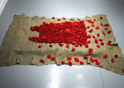 Bed of Roses, 2012: Wool, cotton flannel, cotton fabric, wool fabric, foam stuffing, polyester stuffing, thread; hand felted, machine sewn - $2,000