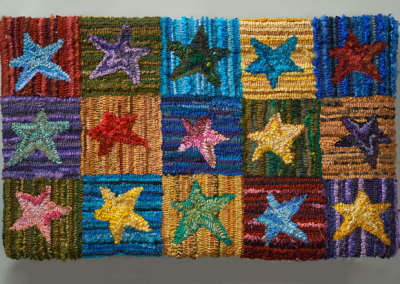 Jean Ottosen: Star Rug, 2012. Hooked rug wall hanging, $700.