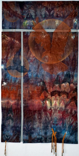 Another Moment - Another Story, 2011. $1,680. 42h x 20w (inches). Hand-dyed cotton, textile oil stick, polyester sheer, fibre glass screening, tulle, beads, leather thong, rayon floss, hand embellished, copper embellishments.