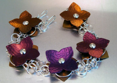 Floating Flowers Bracelet: Melody Armstrong, Sterling Silver, Anodized Titanium