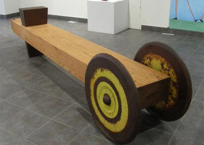 Hosaluk: Stonehouse Bench - 2013, Packer wheels, steel wedge, fir (from Prince George Hotel), steel bearings. $10,000