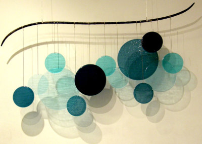 Aqueous (Elaina Adams), 2012: Fused glass, forged metal. $750