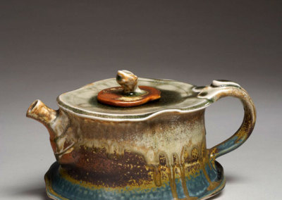 Judy Tryon, Full Steam Ahead, 2011 - clay, glazes; wheel thrown, altered, assembled with slab top & base, pulled handle, cone 10 reduction fired
