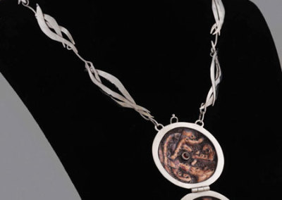 Shannon Welch, Lock-it, 2011 - sterling silver, copper, garnet; chasing & repoussée, fabrication