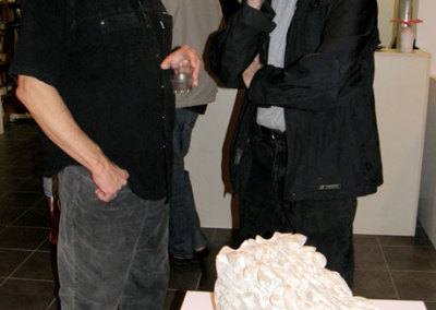 Daryl Richardson & SCC Exhibitions and Education Coordinator Les Potter next to Karen Humble's carved stone Scroll Bracket.