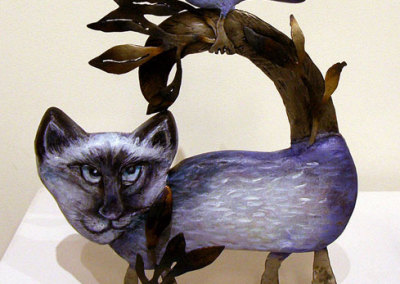 Miranda Jones, Saskatoon, SK - Cunning Cat, 2012. Cedar, metal, paint, $980