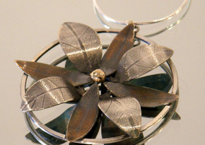 Bloom Pendant #1, Megan J. Hazel, 2011, Sterling silver & 14k gold