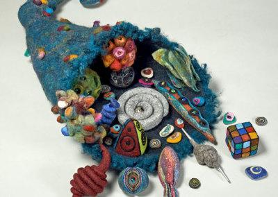 Heike Fink: Cornucopia, 2013. Cornucopia filled with 14 felted pieces & 18 tiny filling pieces, $950.