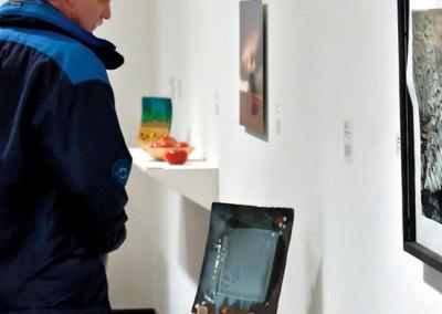 Seeds Reception - Guest Admiring Work