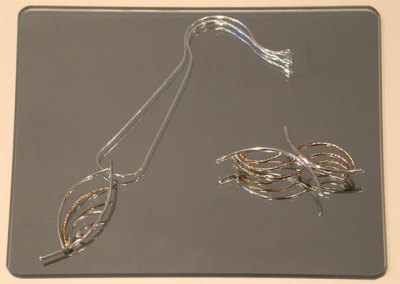 Pendant & Brooch, Megan J. Hazel, 2011, Sterling silver, 14k gold & diamond