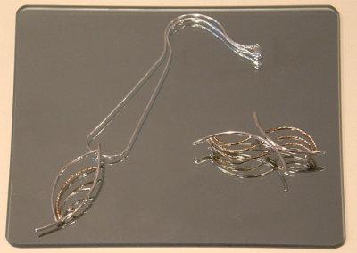 Pendant & Brooch, Megan J. Hazel, 2011, Sterling silver, 14k gold & diamond