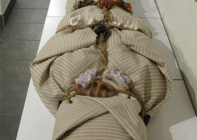 Shroud for a Green Burial (Puck Janes), 2012: 100% printed cotton, jute rope, clay and glazes, miscellaneous stuffing. NFS