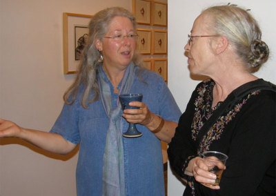 Curator Judy Haraldson talking with Cathryn Miller