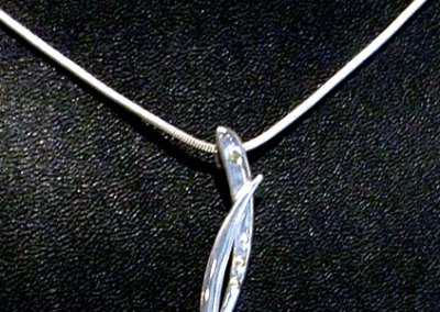 Eclipse Pendant by Evan Hauser, 2011 - Stirling silver, diamond. $120