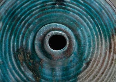Mel Bolen: Evidence, 2013. Salt-fired porcelain altered vase with 3 legs, $1,200.
