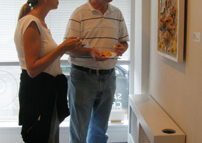 A couple of Fine Craft Patrons enjoying Wendy Parson's Chickens