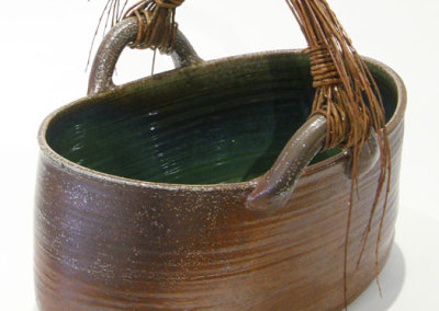 Eleanor Fernandez & Matina Morton, Moses: Stoneware, glass, willow; wheel thrown, altered, basket weaving. 2013, $1,500.