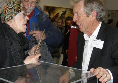 Lorne Calvert signing Premier's Prize for Cathryn Miller
