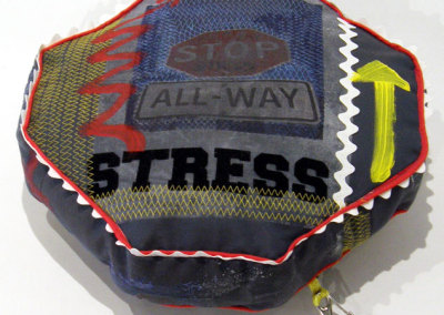 Sandra Epp, Stop Stress: Recycled fabrics, trims; photo transfer, sewing, painting. 2013, $70.