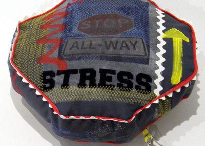 Sandra Epp, Stop Stress: Recycled fabrics, trims; photo transfer, sewing, painting. 2013, $70.