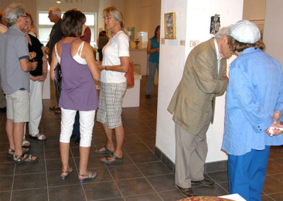A vibrant crowd of Fine Craft patrons taking in the Treasures exhibition