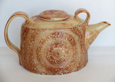 Oval Teapot-hand built of textured porcelain slab. Glazed.
