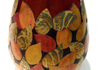 Falling Leaves: Debra McLeod, 2011 - Birch wood, paint, gold leaf; Turned, burnt, painted, and gold leafed. $600