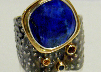 Melody Armstrong, The Ring: Sterling silver, 14k gold, lapis lazuli, sapphire, hessonite garnet; stone setting, soldering, texturing. 2013, $950.