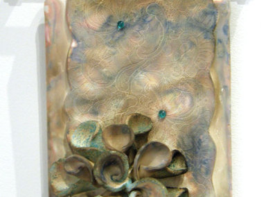 Susan Robertson, Fleur, Wall Jewel Series II: ∆6 stoneware clay, frit, glass beads; slab, hand built, pit fired. 2013, $195.
