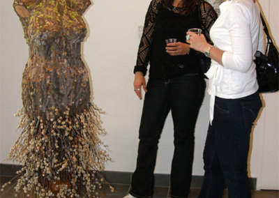 Two guests admiring Bark Woman.