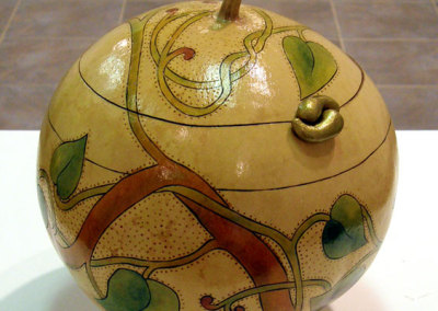 9Winding: Julie-Anne Wallewein, 2010 - Gourd, apoxie sculpt; carved, pyrographed. $120