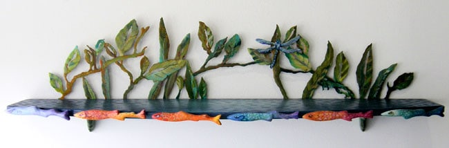 Miranda Jones, The Rainbow Trout Come Out: Wood, mild steel, acrylic paint, magnets; carved, plasma cut steel, painting. 2013, $2,500.