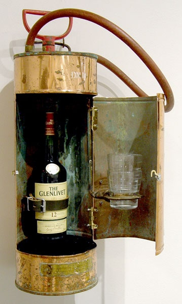 OCC Craig Campbell, Saskatoon, SK - Burn Baby Burn. Antique fire extinguisher, wood, shot glasses, scotch, $750