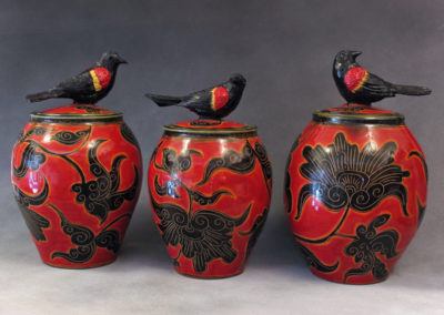 11. 12. 13. Red-winged Backbird Jars (Debra Kuzyk and Ray Mackie), 2016: Cone 6 porcelain; red decoration. $750 each.