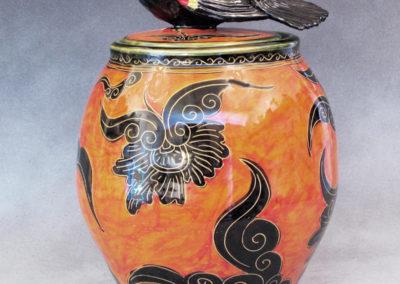 13. Red-winged Backbird Jar (Debra Kuzyk and Ray Mackie), 2016: Cone 6 porcelain; orange decoration. $750.