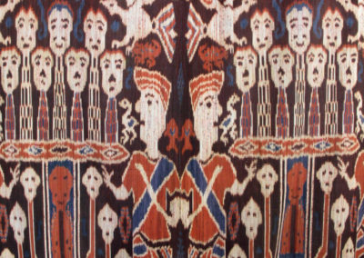 Kampung Sumba (Village Scene cloth) (Rende Royal Family - Unknown artist): Dutch cotton, indigenous natural dyes (Mengkudu root, Indigo plant, kayu (tree dye- Yellow)): Ikat technique and hand woven on back-strap loom. $2000