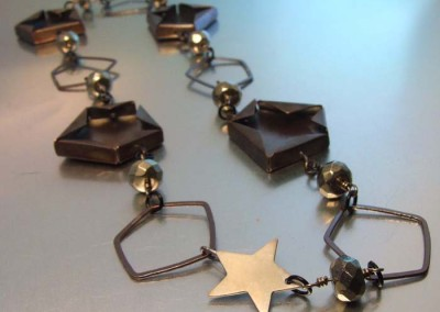 SILVER STAR CLASP AND PENTAGON LINK CHAIN – Melody Armstrong, 2014, copper, sterling silver, iron pyrite beads, fabricated, scoring and bending, soldered, oxidized, 3.2 x 53.2 x 1 cm.  $850